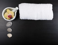 Spa treatment essentials. Beauty and spa treatment essentials on a dark wooden background Stock Image