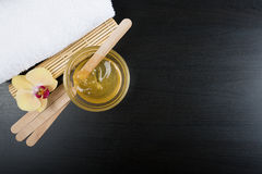 Spa treatment essentials. Beauty and spa treatment essentials on a dark wooden background Stock Photography