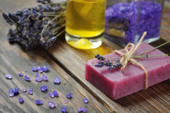 Spa treatment. Herbal soap with oil, sea salt and lavander flowers Royalty Free Stock Photos