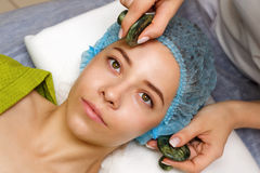 Spa treatment. Massage with jade stones Royalty Free Stock Images