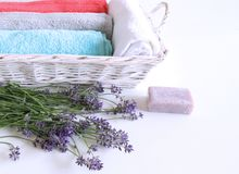 Spa treatment and massage products with towel, aromatic oil ,natural soap and lavender flowers on a white background. Relax witha spa concept stock photos
