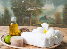 Spa treatment with olive oil and lime and soap with towels Stock Photo