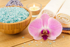Spa Treatment with pink flower, towels and sea salt Royalty Free Stock Photo