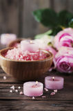 SPA treatment with pink salt and candles Royalty Free Stock Image