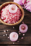 SPA treatment with pink salt and candles Stock Photography