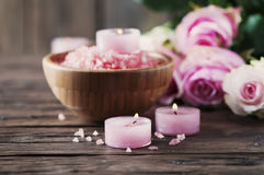 SPA treatment with pink salt and candles Royalty Free Stock Photo