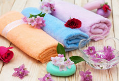 Spa treatment. Preparing for bath, towels,soaps and flowers Royalty Free Stock Images