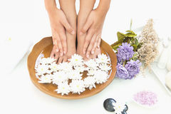 Spa treatment and product for hand and foot spa with flowers and water. Wooden background; select and soft focus Royalty Free Stock Photos