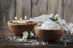 SPA treatment with salt, almond and candles. Selective focus Royalty Free Stock Photography