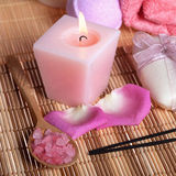 Spa treatment: sea salt, candle, soap, roses petals Stock Photos