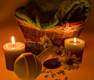 Spa treatment: sea salt, candles, flowers and towel Stock Photo