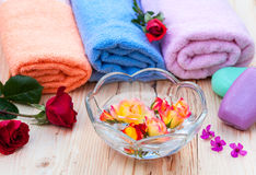 Spa treatment. Spa set with towels and roses Stock Photo