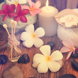 Spa treatment setting with frangipani Stock Photography