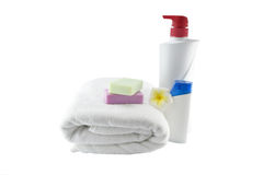 Spa treatment with soap towels, plastic bottle and flower on whi Stock Images