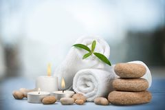 Spa Treatment. Towel Candle Wellbeing Stone Isolated Zen-like Royalty Free Stock Photography