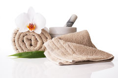 Spa treatment towel orchid pestle and mortar. On reflective white surface stock photography