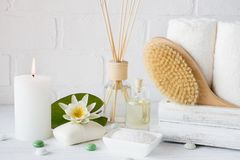 Spa treatment - towels aromatic soap, bath salt, and oil, and accessories for massage. And bathroom stock images