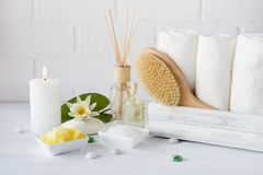 Spa treatment - towels aromatic soap, bath salt, and oil, and accessories for massage stock photos