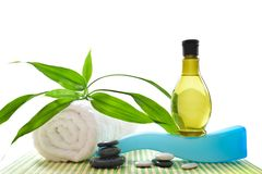 Spa treatment with towels and green bamboo stock image
