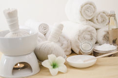 Spa treatment with towels and herbal creams Stock Images