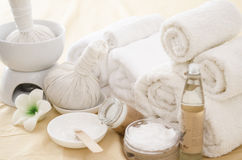 Spa treatment with towels and herbal creams Stock Photography