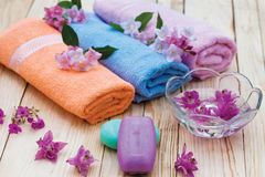 Spa treatment. Tranquil scene with bath and relaxation items Stock Photos