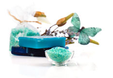Spa treatment with turquoise bath salts Royalty Free Stock Photos