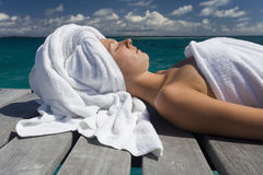 Spa Treatment on vacation in the South Pacific. A young woman resting after a spa treatment on vacation in French Polynesia in the South Pacific royalty free stock photos