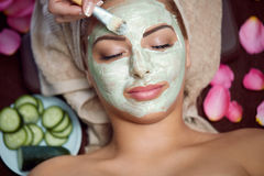 Spa treatment. Woman receiving spa treatment with cosmetic mask, skincare, antiaging, acne royalty free stock photography