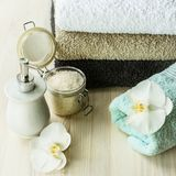 Spa treatments, spa items. Towels, soap, sea salt on wooden background Royalty Free Stock Image