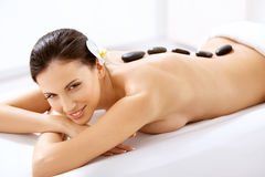 Spa Tretment. Woman Getting Stones Massage. Spa Tretment. Beautiful Woman Getting Spa Hot Stones Massage in Spa Salon stock photography