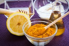 SPA Turmeric face mask set. Making of the Turmeric face mask receipt set for SPA resort. Ingredients: -1/2 teaspoon turmeric powder -½ teaspoon organic apple stock image