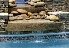 SPA Waterfall Feature. Waterfall feature running warm water from the SPA into the Swimming Pool stock photo