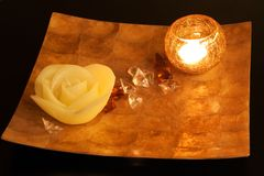 Spa and wellness. Shot of plate with spa beautiful arrangement made with flower, stones and lighten candle Royalty Free Stock Image