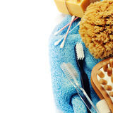 Spa and Wellness. Anti-cellulitis spa massage brush, sponge, towel  and soap over white Royalty Free Stock Photography