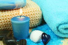 Spa and wellness in blue. Spa soothe in blue color. Wellness therapy with pebbles, shell and candle Stock Photography