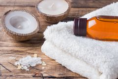 Spa and Wellness concept on wooden background. Terry towel and cosmetic oil for massage. Spa and Wellness concept on wooden background. Terry towel and cosmetic royalty free stock photos