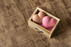 Spa and wellness concept: wooden box with pink sea salt and heart shape soap with word `love` on it Stock Images