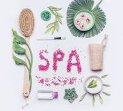 Spa or Wellness flat lay on white background. Body care and cellulite treatment tools. Natural brush for dry skin peeling or massage , cream and luffa sponge royalty free stock photo