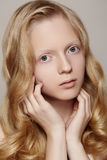 Spa, wellness & healthcare. Beautiful girl model with clean skin, curly blond hair royalty free stock images