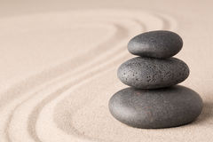 Spa wellness hot stone therapy. Or zen meditation stones and sand for relaxation and concentration Royalty Free Stock Image