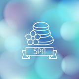 Spa wellness label on blurred background Stock Photo