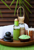 Spa and wellness massage setting Still life with essential oil, salt, stones and cinnamon candle Royalty Free Stock Photography
