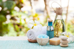 Spa and wellness massage setting Still life with essential oil, salt and stones Outdoor background Copy space. Spa and wellness massage setting Still life with Royalty Free Stock Images