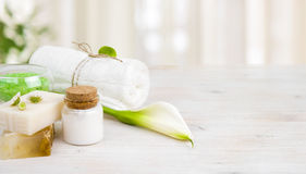 Spa wellness products on light wooden background with copy space Stock Photos