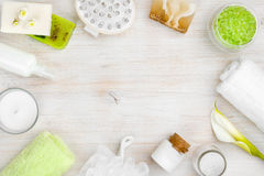 Spa wellness products on wood with copy space in center Royalty Free Stock Image