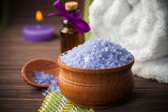 Spa and wellness setting with candles and towel Royalty Free Stock Images