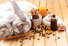 Spa and wellness setting with natural bath salt, candles and towel. wooden background Stock Photos