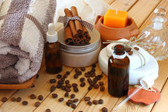 Spa and wellness setting with natural bath salt, candles and towel. wooden background Royalty Free Stock Photo