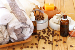 Spa and wellness setting with natural bath salt, candles and towel. wooden background Stock Image
